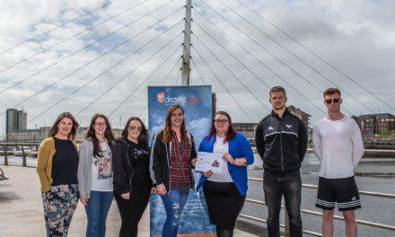 Sporting heroes meet at Swansea-based Dezrezlegal's fundraising handover