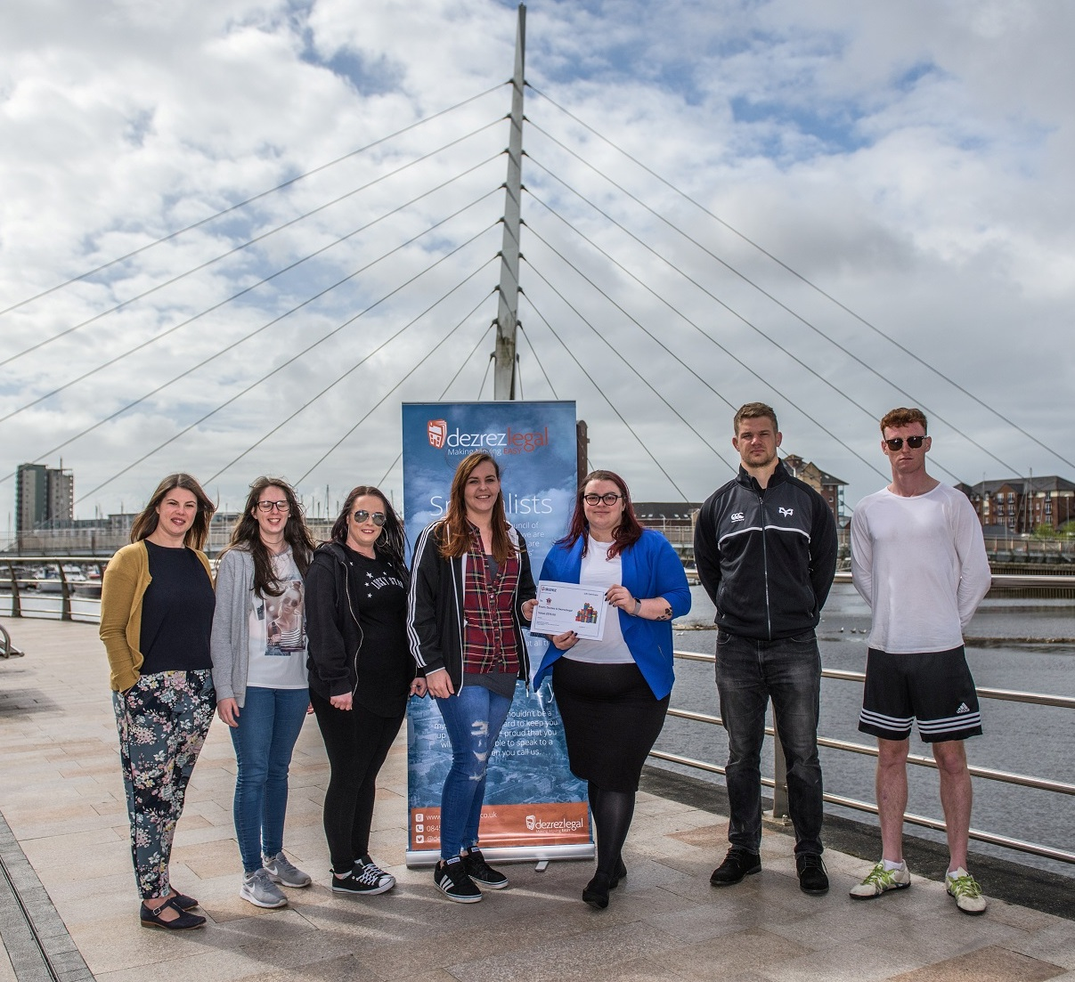 Sporting heroes meet at Dezrezlegal fundraising handover
